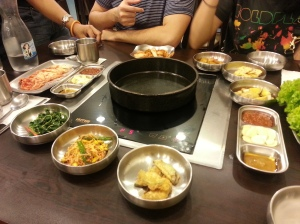 So here is our table. So much banchan, so little time. And for those of you with good eyes you are seeing two kinds of kimchi. The kind that is aged, and the kind that is aged even longer.