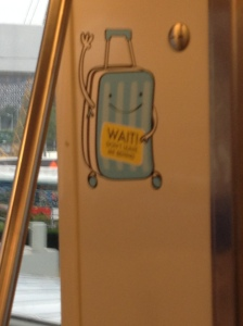 Singapore has so many adorable signs to help you get around, like this one that makes sure you don't forget your luggage.