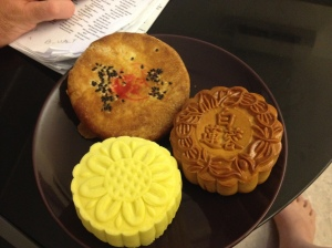 Soft skin Durian (the yellow one), Traditional I believe Lotus Paste (the one on the right), and I believe the last one is the more Cantonese style mooncake, a bit more savory